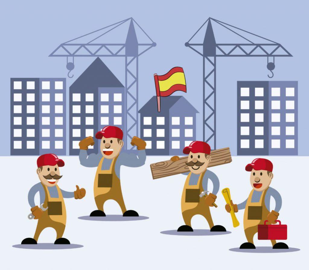 bandera de españa encima de edificios en obras